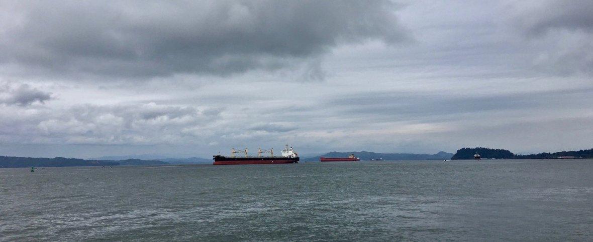 Cargo ships on the Columbia River Astoria Oregon waterfront