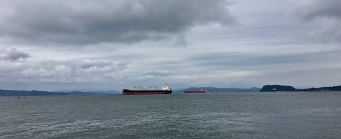 Cargo ships on the Columbia River Astoria Oregon waterfront