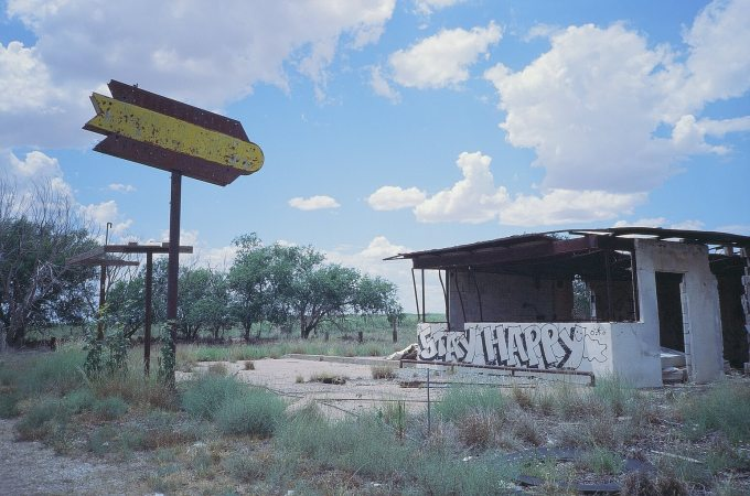 Expired Kodak Elite Chrome 35mm film photograph Burned out liquor store. STAY HAPPY West Texas
