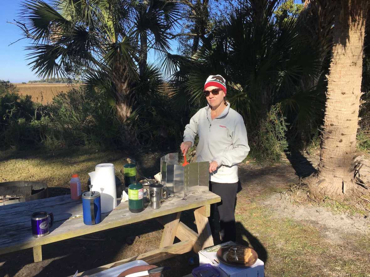 Marsi cooking camp breakfast on a cold Florida morning