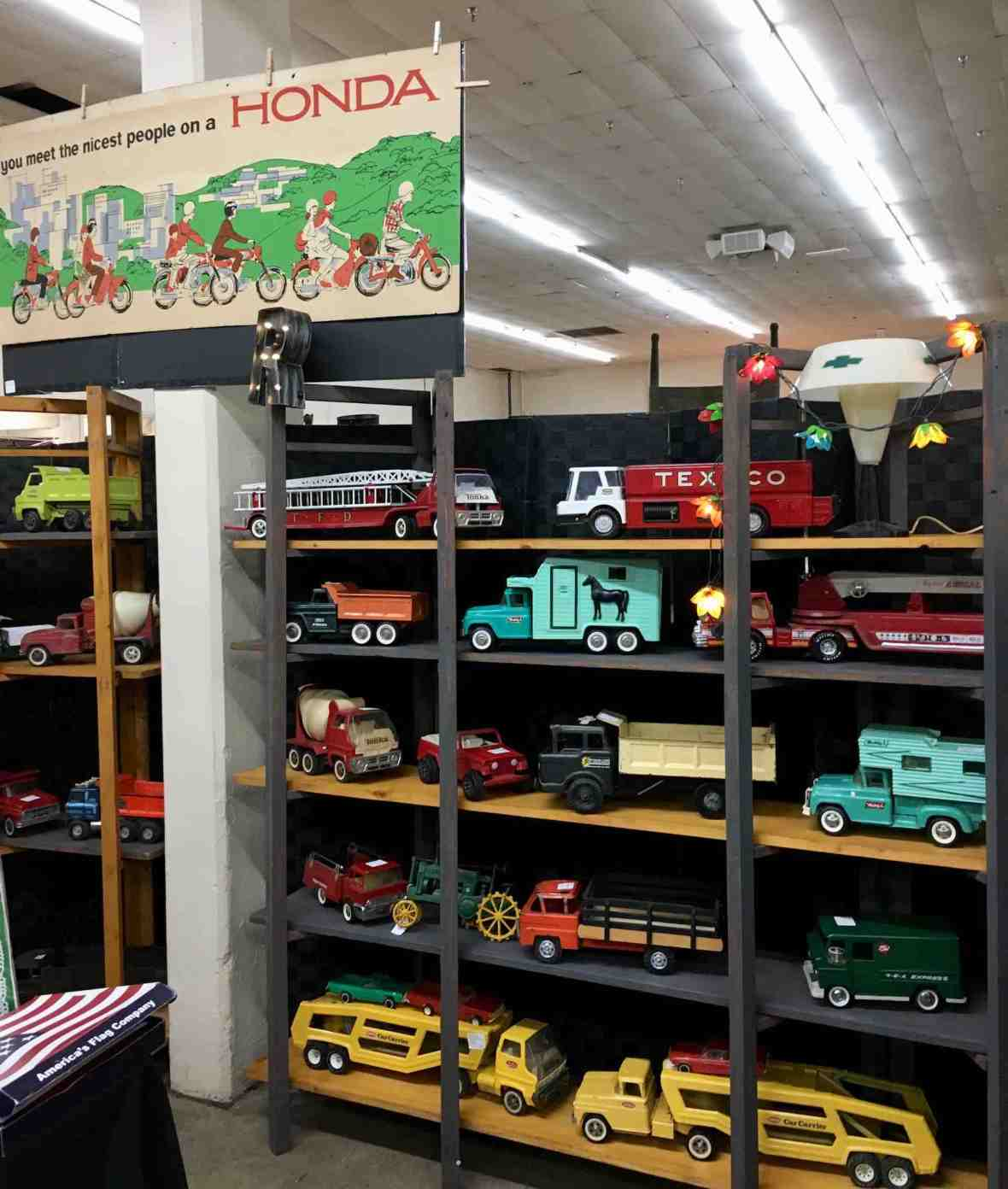 Indoor booth with huge collection of vintage toy trucks at Nashville Flea Market