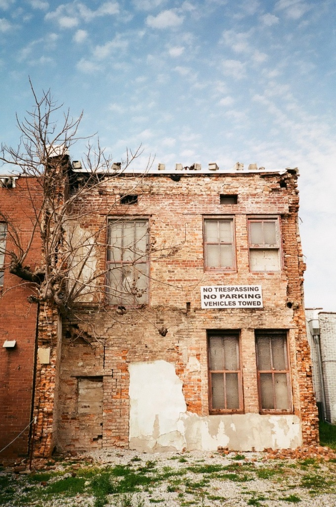 35mm photography photograph A tree grows out of an abandoned building in McMinnille, Tennessee