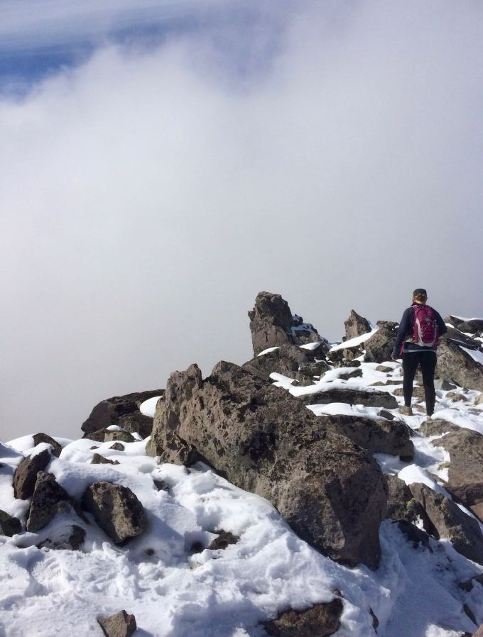 Maneuvering through the boulders and snow atop Third Burroughs