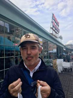 Robert eats the craziest looking grapes outside Pike's Place Market