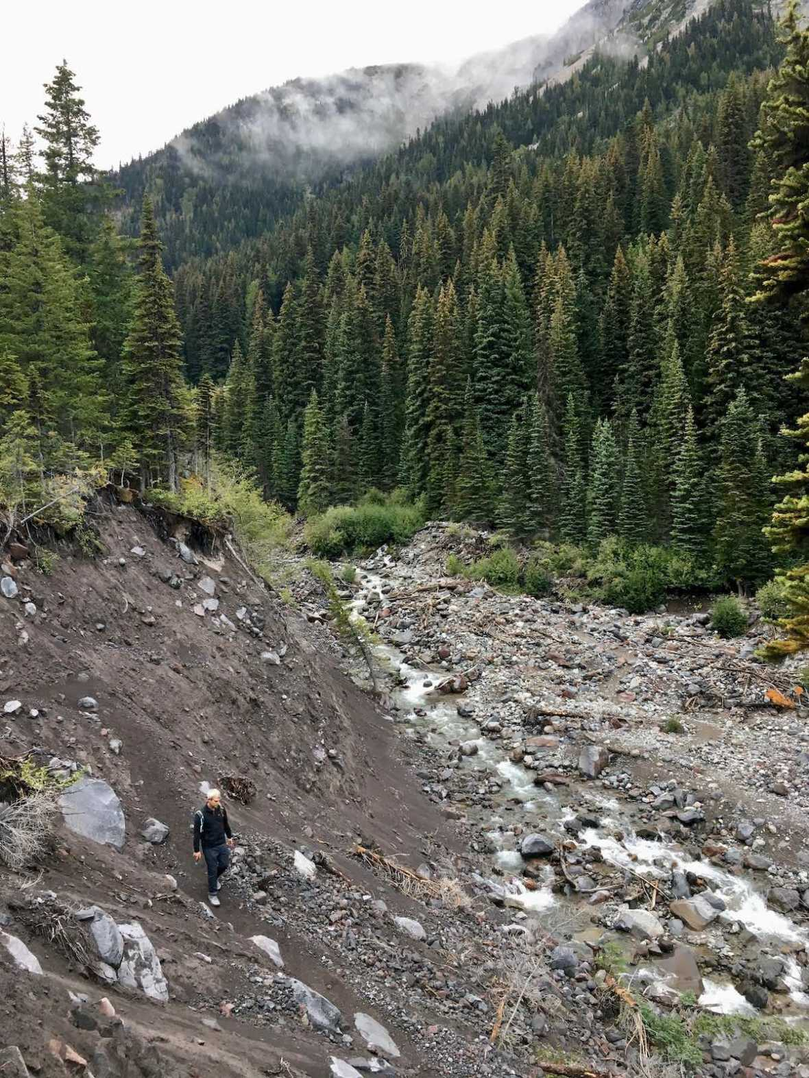 Hiking back down the Emmons Morraine about to cross the White River in Mount Rainier National Park.
