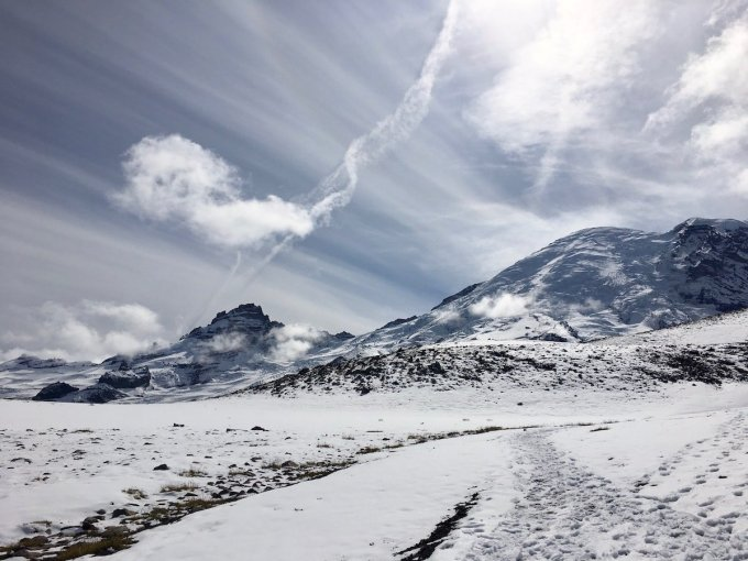 Clouds radiating from Mount Rainier views from trail between Second and Third Burroughs
