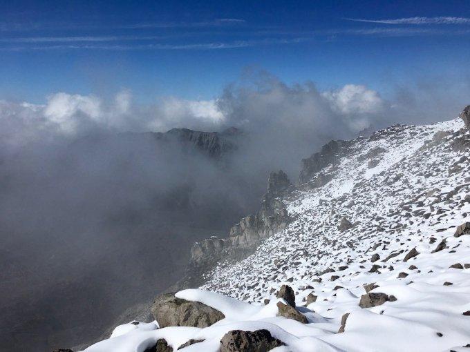 Boulder field atop Third Burroughs, Mount Rainier clouds in the glacial valley below