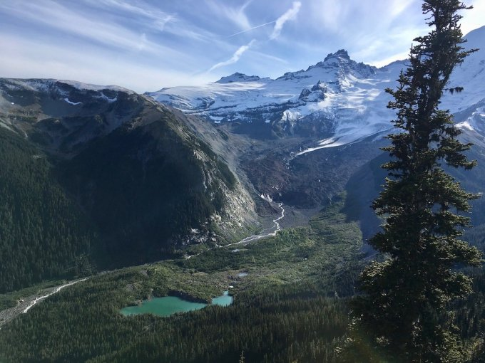 Views of a glacial lake, the White River, Emmons Moraine, Emmons and Frying Pan Glaciers, Little Tahoma Peak, and Goat Island Mountain from the Sunrise Rim trail in Mount Rainier National Park