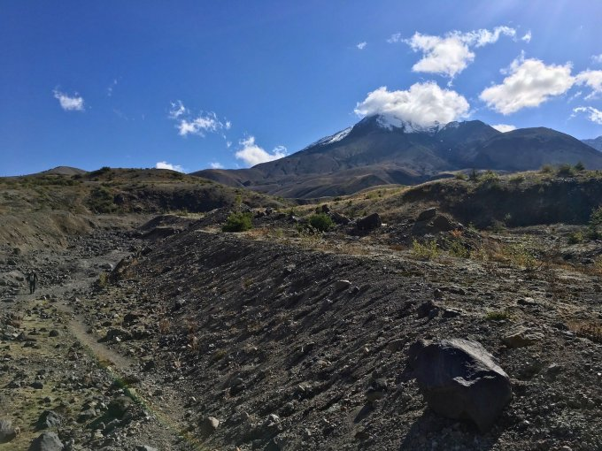 Hiking through a large wash in the pumice field at Mount St. Helens National Volcanic Monument
