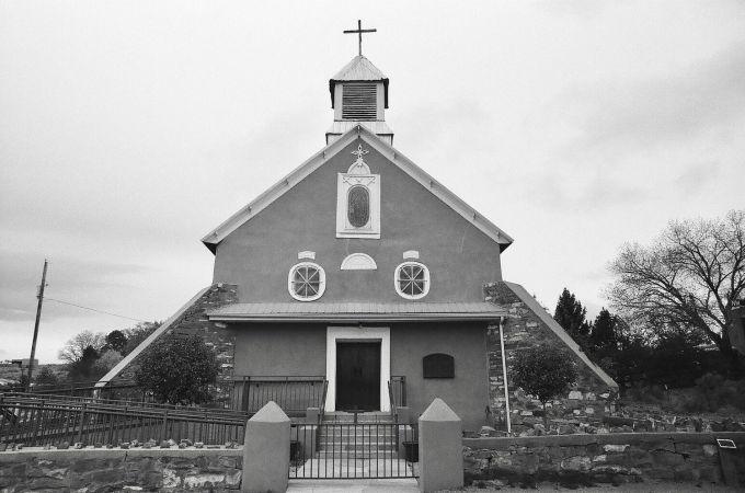 35mm black and white film photograph of Iglesia Nuestra Señora de Los Remedios Church in Galisteo, New Mexico