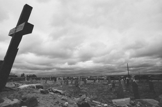 35mm black and white film photograph - Old walled cemetery in Galisteo, New Mexico