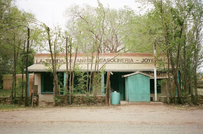 35mm film photograph of abandoned jewelry store and gas station in Galisteo, New Mexico