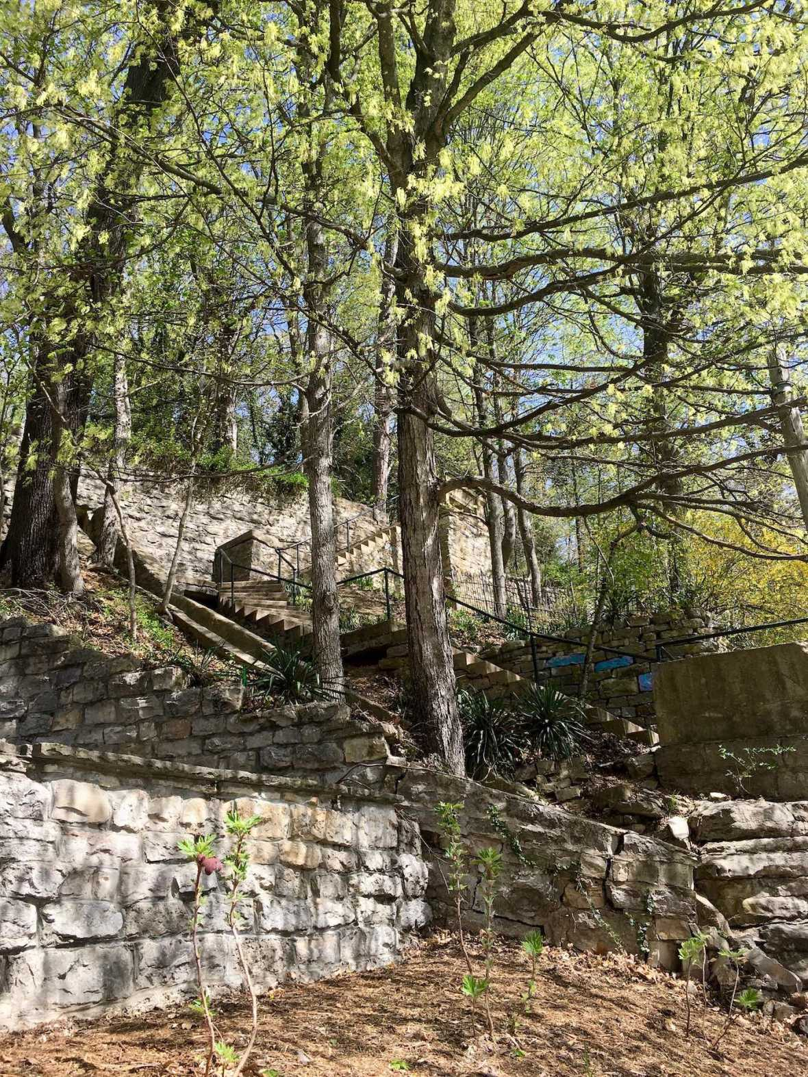 Stone stairway to leading wooded path in historic downtown Eureka Springs, Arkansas