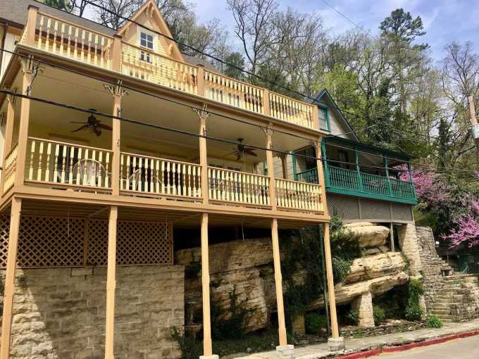 Historic homes built atop and around the limestone bluffs in Eureka Springs, Arkansas