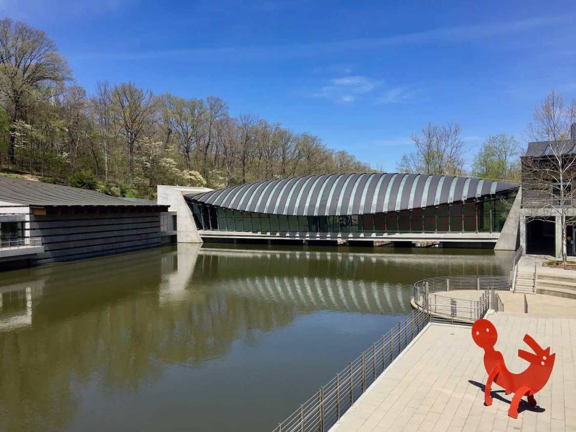 Banded Copper Roof and pond Moshe Safdie-designed Crystal Bridges Museum of American Art in Bentonville, Arkansas