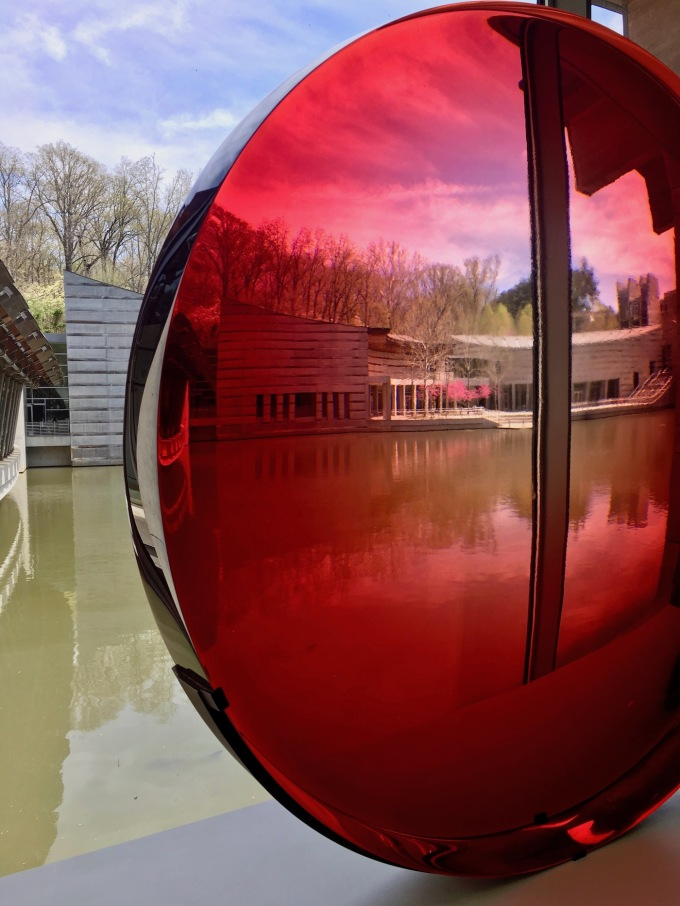 Big Red Lens by Frederick Eversly at Crystal Bridges Museum of American Art
