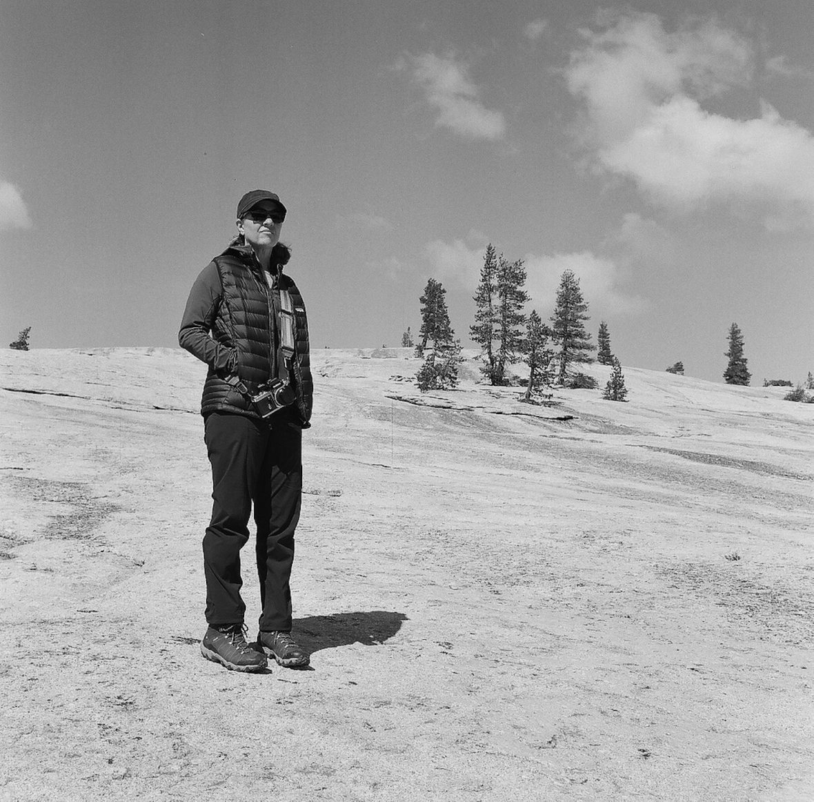 Medium format 120mm monochrome film photography Marsi hiking a granite dome in Yosemite National Park