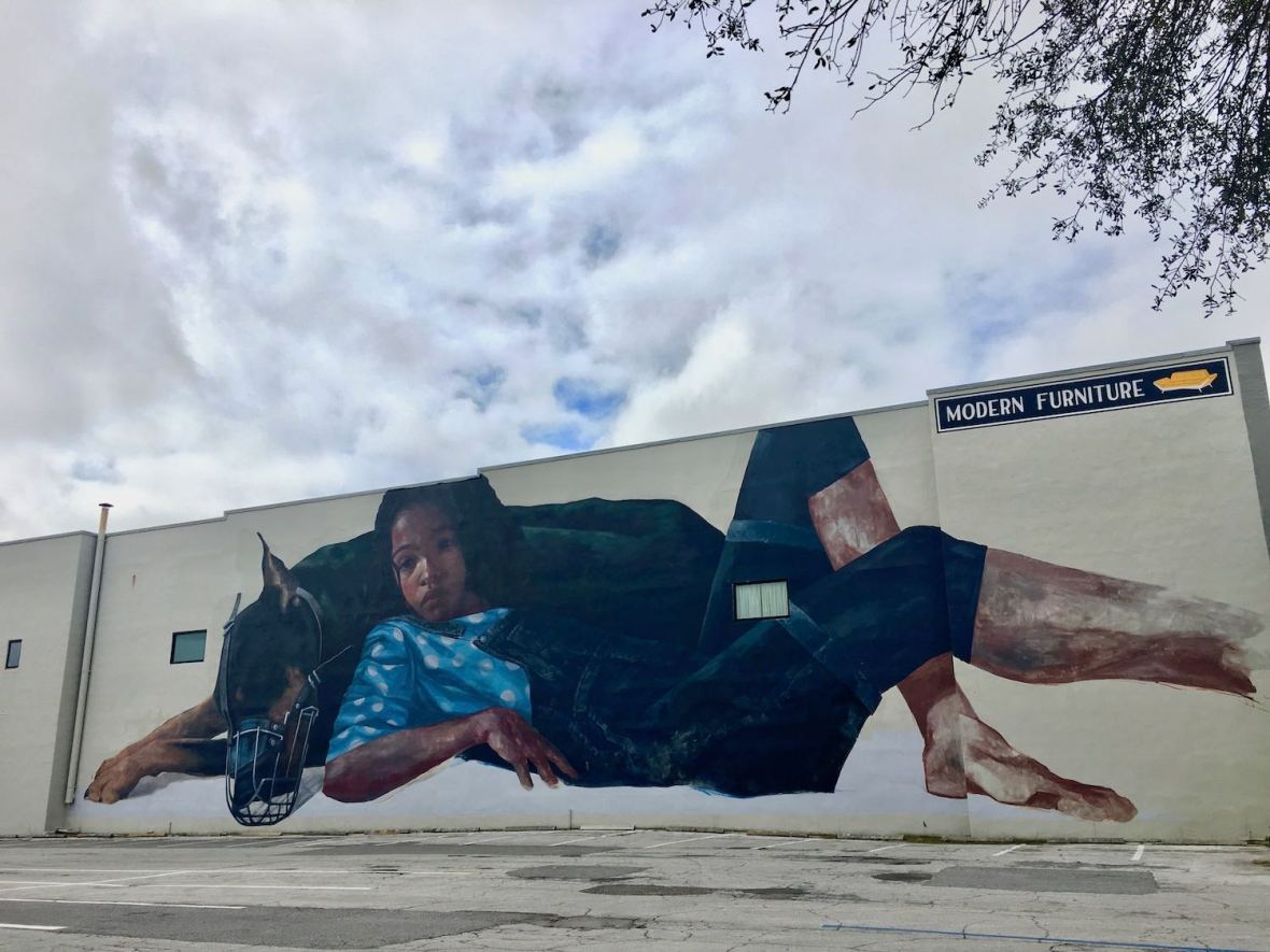 Mural on the side of Furnish Me Vintage Building in St. Petersburg Florida