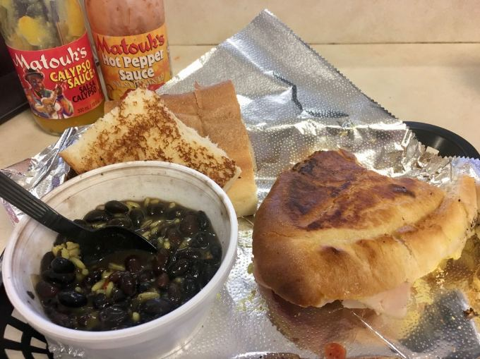 Tampa Bay's best authentic Cuban sandwich with black beans and yellow rice at The Floridian Restaurant in Treasure Island, Florida