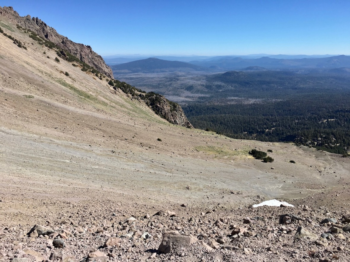 Lassen Peak smoothed by glaciers, beyond it skeleton forest visible from recent wildfires