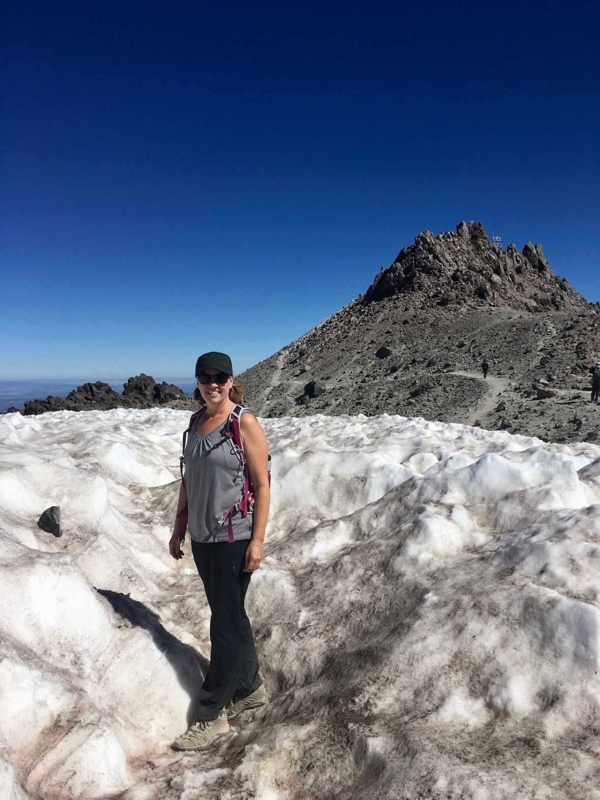 Marsi hiking through permanent snowfield, toward the summit of Lassen Peak in Lassen Volcanic National Park