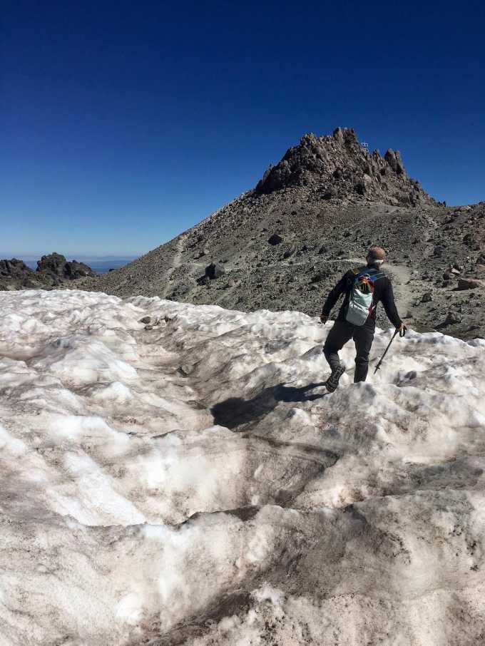 Hiking through the glacier toward the summit of Lassen Peak in Lassen Peak Volcanic National Monument