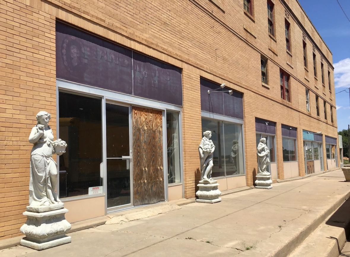 Grecian Statues outside abandoned building in Memphis, Texas