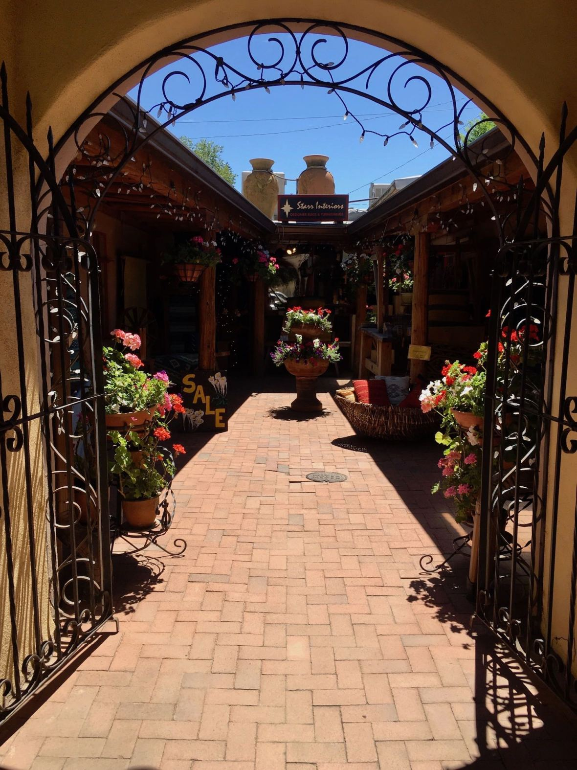 Flower pots and arch in Taos, New Mexico courtyard