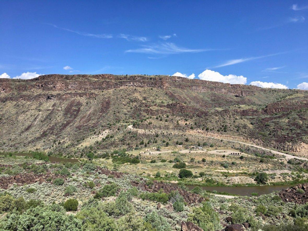 View of the tiny Taos Junction campground and NM-570 up the Western side of the Rio Grande Gorge