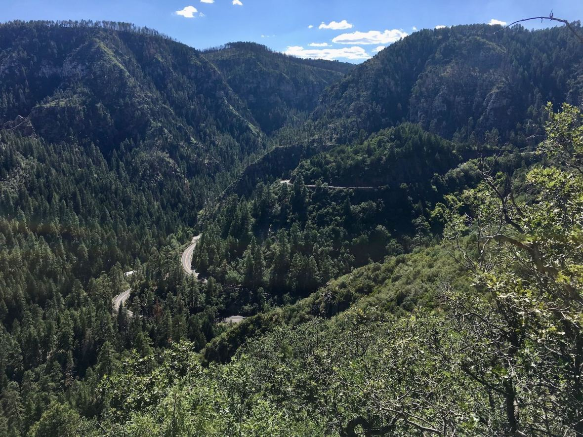 Hwy 89A switchbacks through Coconino National Forest viewed from Oak Creek Vista